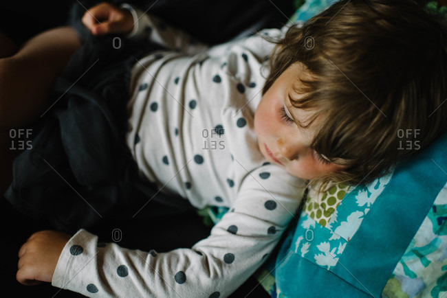 close up of girl napping in an armchair