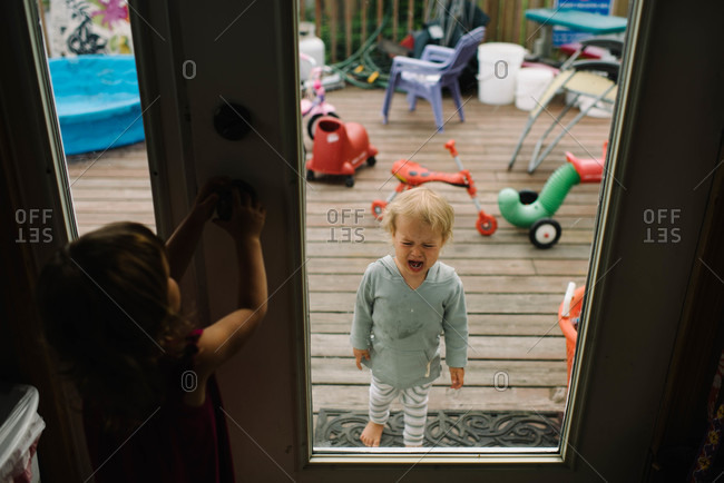 Girl locking out a little boy