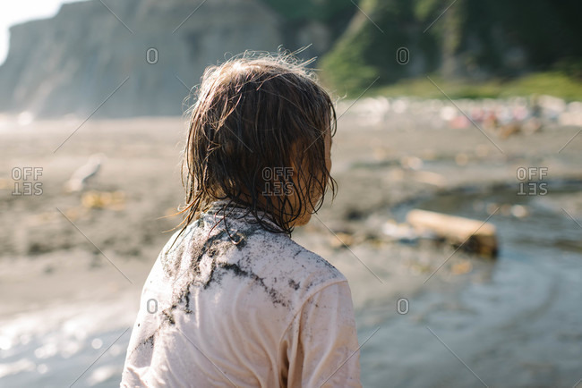 Boy's t-shirt covered in sand on the beach