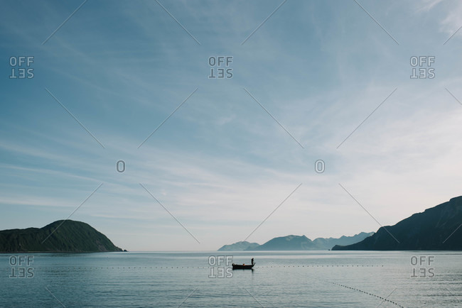 Fisherman standing on a boat