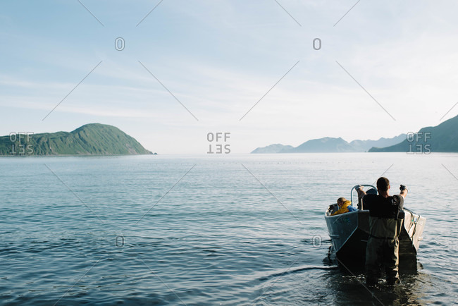 Fisherman pulling his boat to the shore