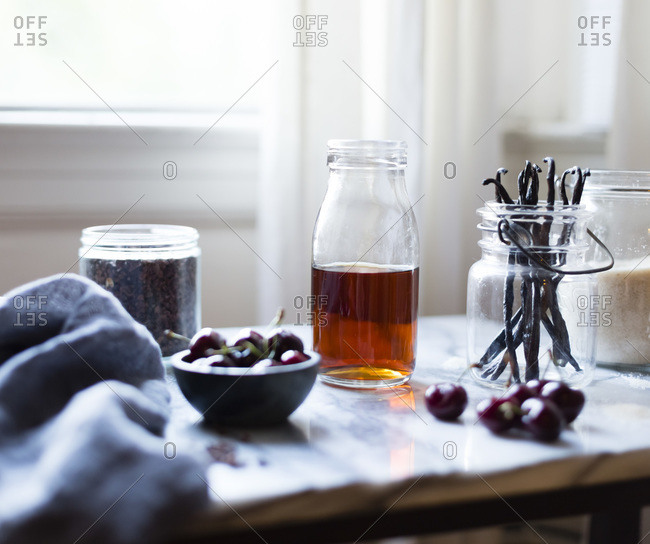 Ingredients for a cherry soda on a table