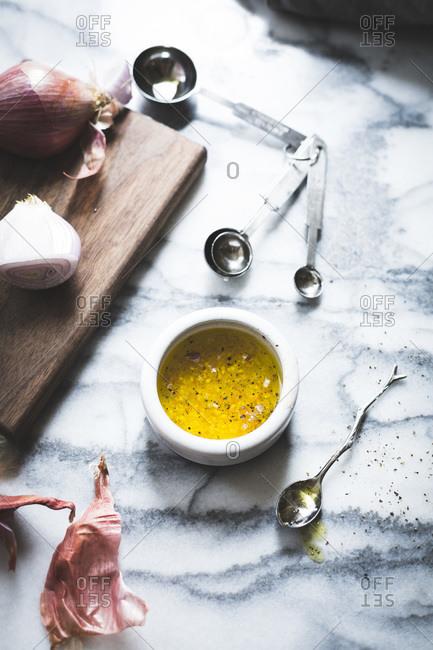 Garlic vinaigrette on a marble counter