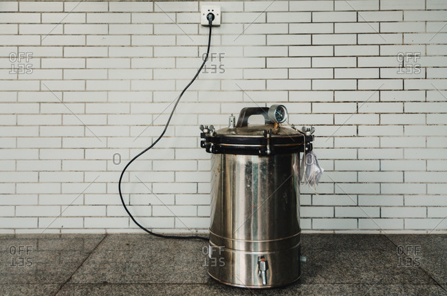 An electric autoclave used to sterilize equipment