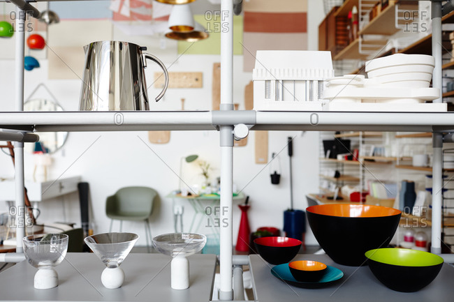 Modern home furnishings on a shelf in a boutique