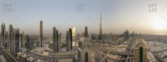 Interchange at Sheikh Zayed Road and Dubai skyline at sunset