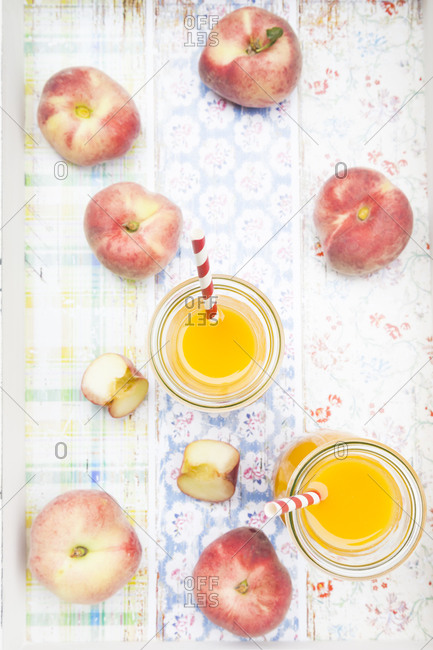 Overhead view of peaches and smoothies
