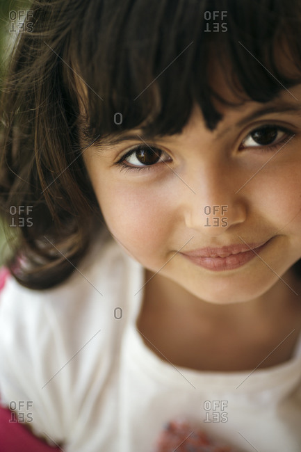 Portrait of smiling little girl with brown eyes