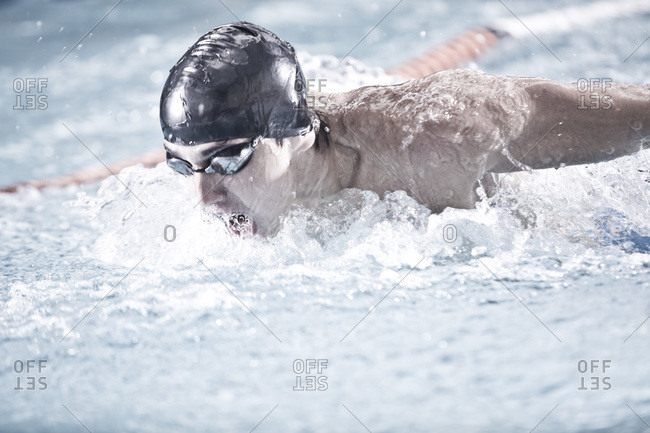 Close up of a swimmer practicing in indoor pool