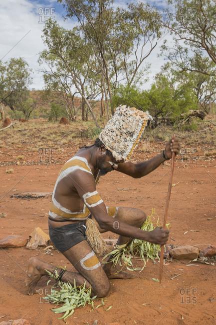 Cloncurry, Queenstown, Australia - January 27, 2014: Marrinyama Man dancing on sacred ground in Western Queensland, Australia