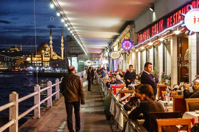Istanbul, Turkey - November 19, 2014: Restaurants under the Galata bridge, Istanbul, Turkey