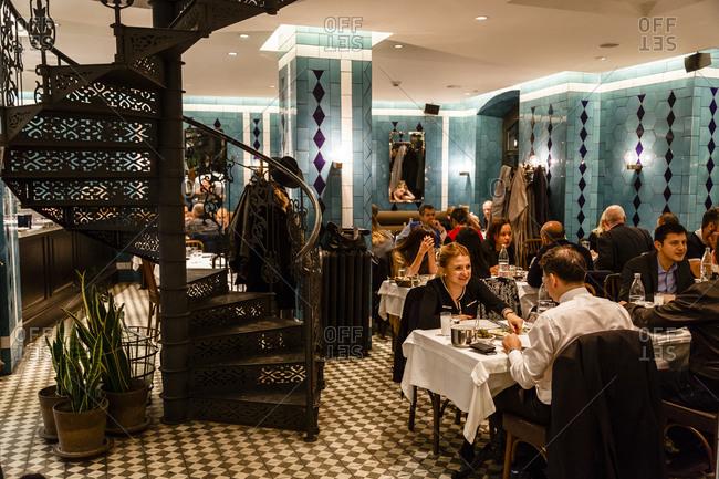Istanbul, Turkey - November 20, 2014: People having dinner in the Karakoy Lokantasi restaurant