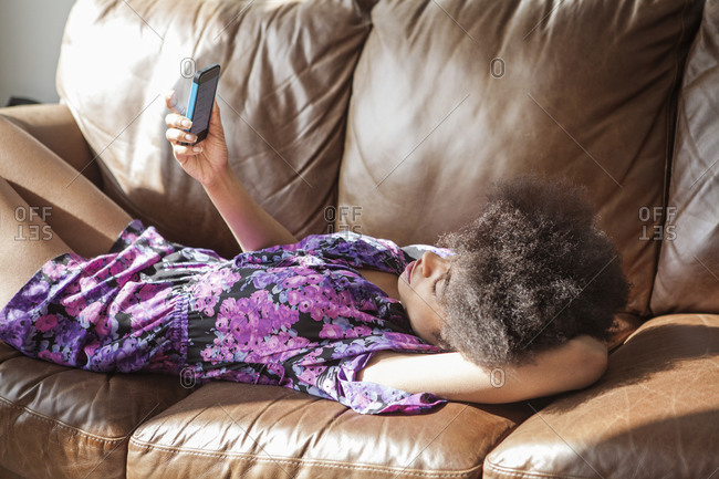 Young woman reading text messages
