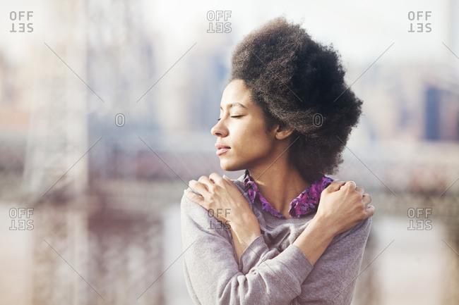 Young woman enjoying the breeze
