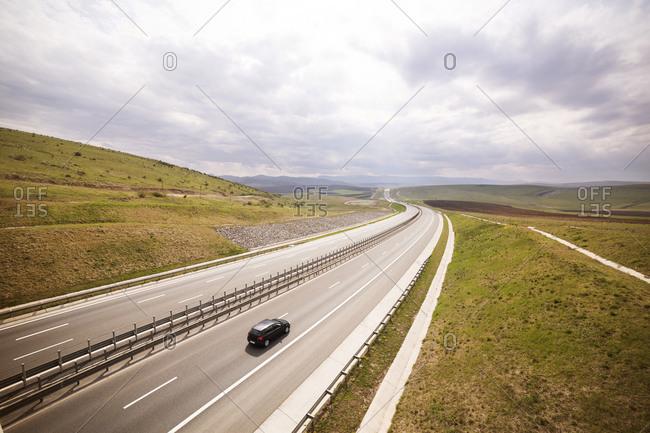 Single car on a highway