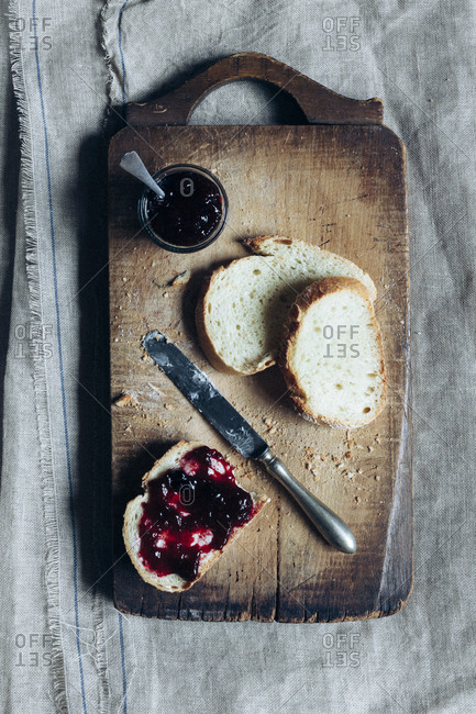 Bread and jam on a cutting board
