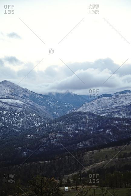 Verdant mountain range against snow capped peaks