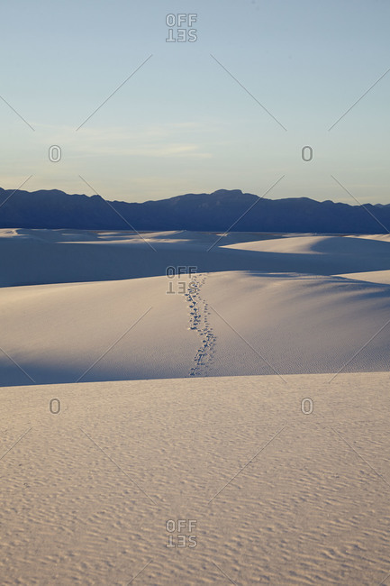 Sand dunes with footprints