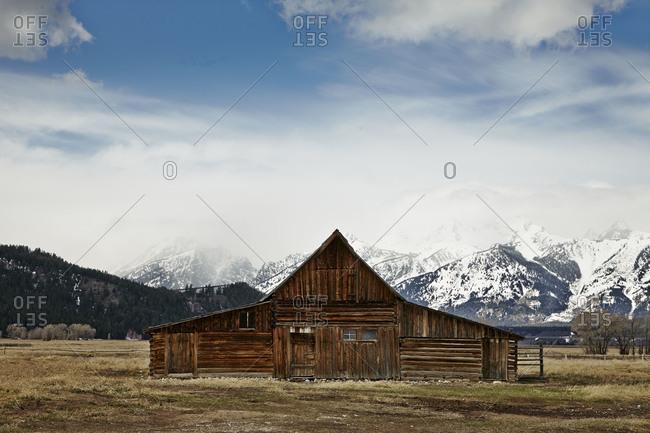 Rustic log building in mountain prairie