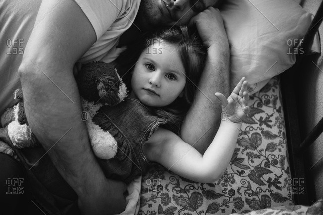 Father snuggling with his daughter