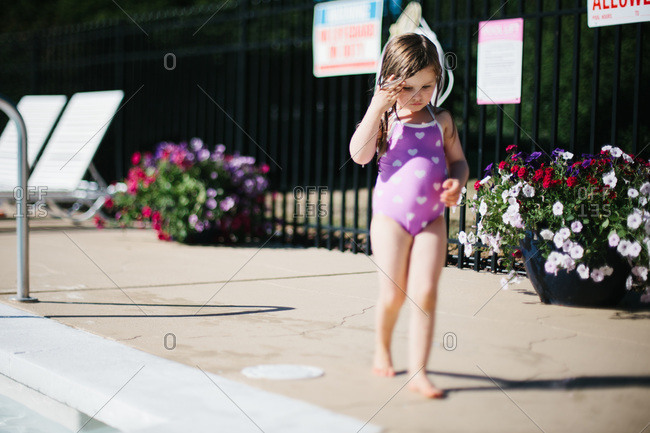 Little girl at a pool