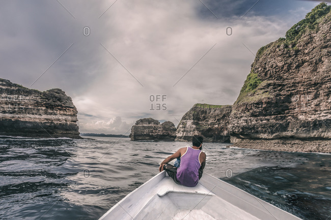Sailing and exploring a rugged coastline in Indonesia