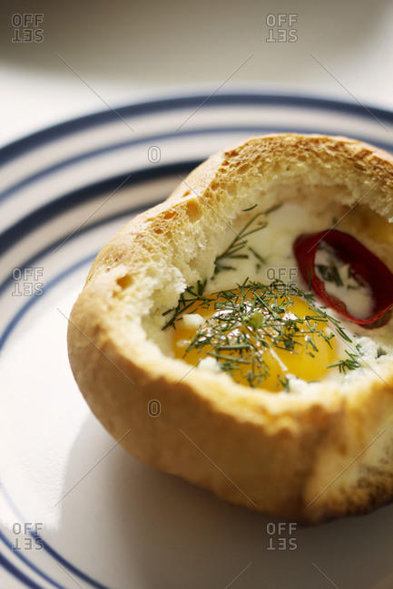 Close up of baked egg in a bun