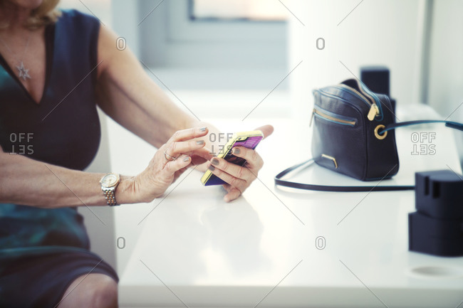 Businesswoman checking her cell phone