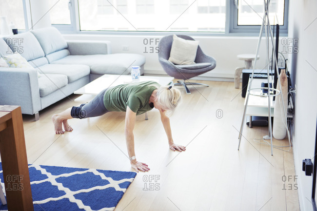 Woman working out in her living room
