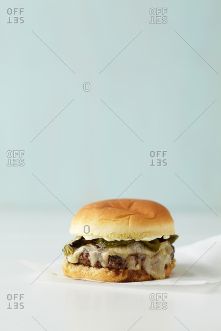 A pepper and onion burger on a napkin