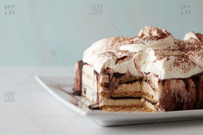 Fudgy ice cream cake with a slice removed