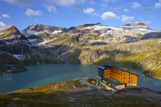 Grossglockner, Austria - September 6, 2013: The Rudolfshut with the Weisssee mountain lake, one of the huts hikers stay at during the Glocknerrunde, a 7 stage trekking from Kaprun to Kals around the Grossglockner, the highest mountain of Austria