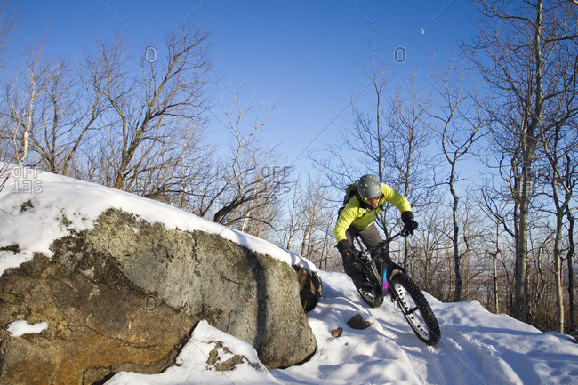Man fatbiking on a trail in winter in Duluth, Minnesota