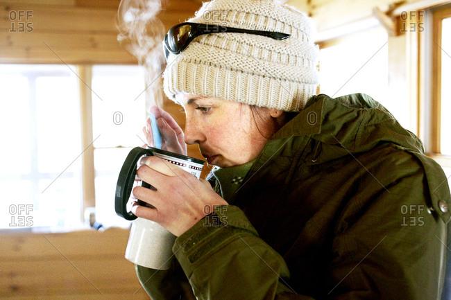 A women drinks a hot drink