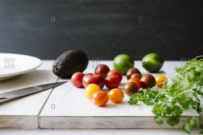 Cherry tomatoes, cilantro, avocado and limes