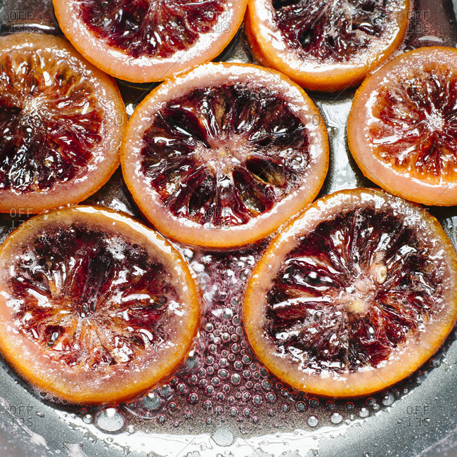 Cooking candied blood orange in sugar syrup
