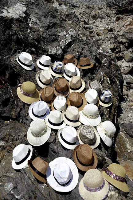 Hats on rocks in Levanto, in the Cinque Terre area of Liguria, Italy