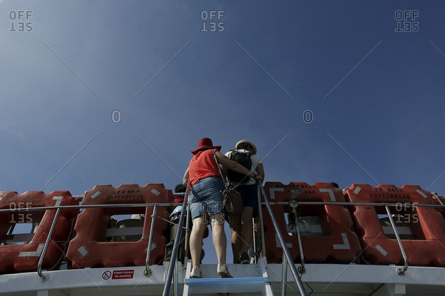 Passengers on a boat's upper deck in Levanto, in the Cinque Terre area of Liguria, Italy