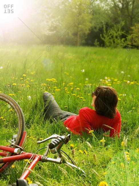 Woman relaxing in a meadow