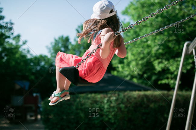 Girl on a swingset