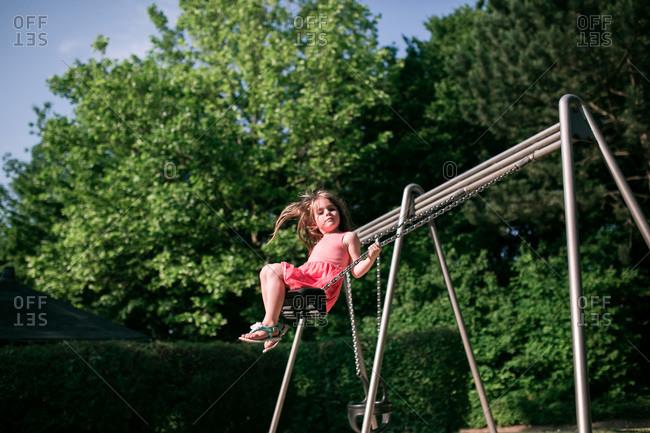 Girl swinging on a swingset