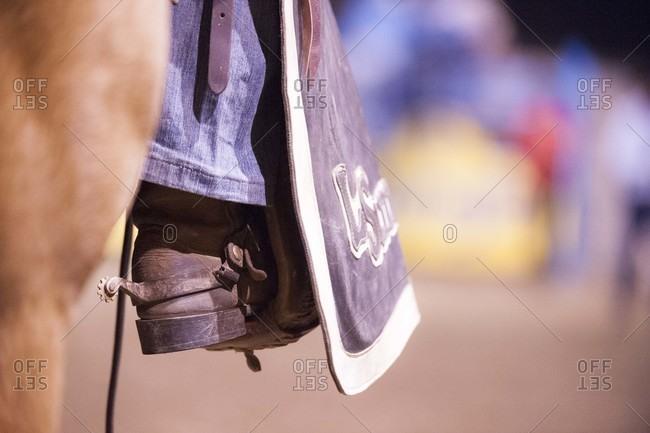 Close up of a man riding a horse