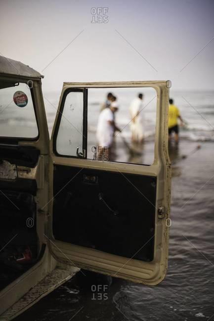 Men fishing in Oman