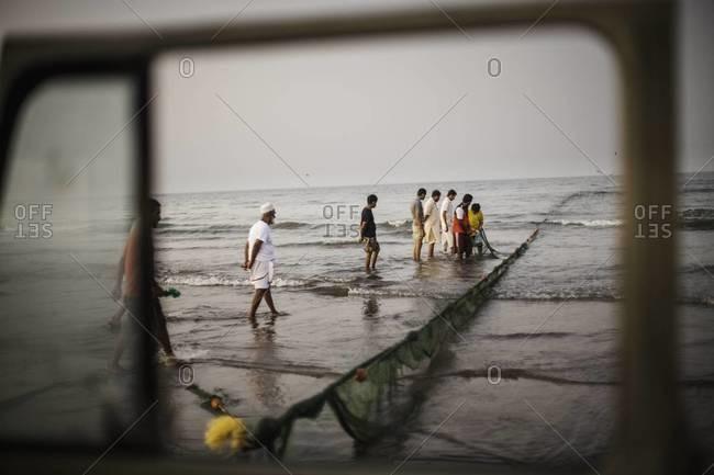 Truck pulling in fishing net in Oman
