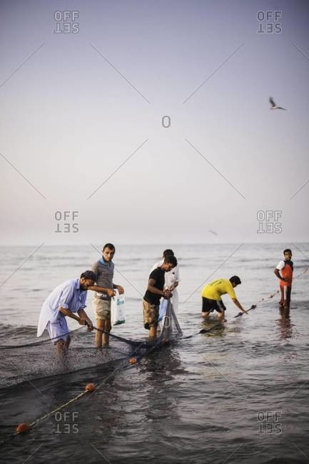 Muscat, Oman - October 18, 2011: Fisherman with net in Oman
