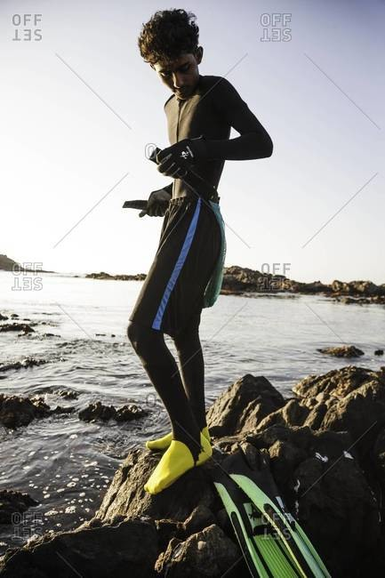 Muscat, Oman - October 20, 2011: Abalone fisherman putting on gear