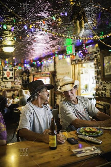 Aspen, Colorado, USA - July 1, 2012: Men chatting in tavern, Colorado