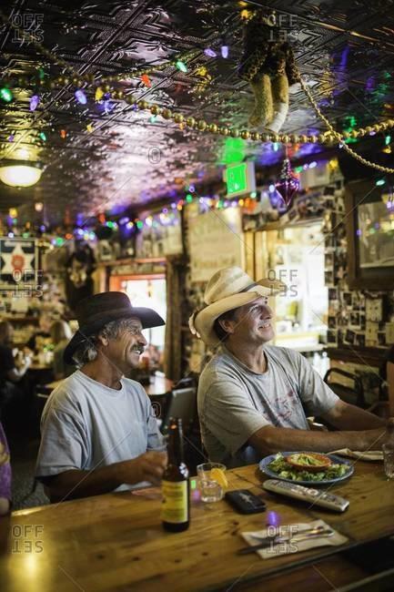 Aspen, Colorado, USA - July 1, 2012: Men watching TV in bar, Colorado