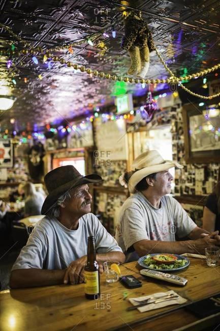 Aspen, Colorado, USA - July 1, 2012: Men watching television in bar, Colorado