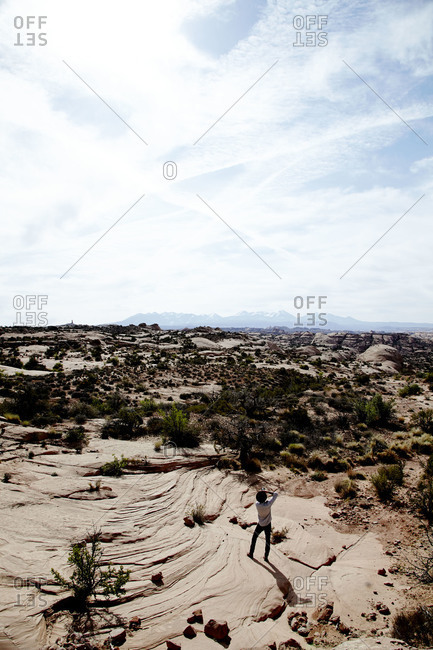 Person standing in barren landscape